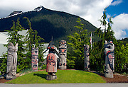 Totem poles in Ketchikan Alaska on the grounds of the Cape Fox Hotel.