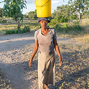CAPTION: Marimbe collects water from a stream near the village of Mawoneke. While this water is understood by its users to be safe to drink owing to the proximity to its source, it tastes brackish and is widely disliked. Villagers tend to have to travel far with heavy buckets in order to bring water for household and agricultural use. The Bindagombe Irrigation Scheme will provide them with more borehole water access points, considerably reducing travel time and the corresponding effort that must be expended. LOCATION: Mawoneke Village, Chivi District, Masvingo Province, Zimbabwe. INDIVIDUAL(S) PHOTOGRAPHED: Marimbe Vimbai.