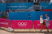 Alongside the Olympic rings logo, a young couple share an intimate moment before the start of the canoe slalom heats at the Lee Valley White Water Centre, north east London, on day 3 of the London 2012 Olympic Games.