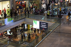 © Licensed to London News Pictures. 13/10/2018. London UK: Security staff at the Westfield shoppin g centre in Stratford where a shopper is believed to have fallen from the upper levels onto a shopper on the lower level at around 3.30 this afternoon. Both shoppers are in hospital in a critical condition , Photo credit: Steve Poston/LNP