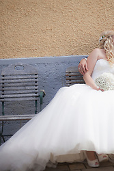 Bride and groom sitting on chair, Ammersee, Upper Bavaria, Bavaria, Germany