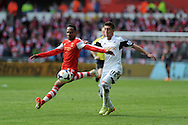 Southampton's Nathaniel Clyne (l) holds off Swansea's Pablo Hernandez. Barclays Premier league match, Swansea city v Southampton at the Liberty stadium in Swansea, South Wales on Saturday 3rd May 2014.<br /> pic by Andrew Orchard, Andrew Orchard sports photography.