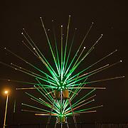 In de periode van 6-12-2013 tot en met 19-01-2014 toont het Amsterdam Light Festival een collectie werken van nationale en internationale kunstenaars, die zich bezig hebben gehouden met het thema Building with Light. Op de foto het kunstwerk Astera op de Oosterdoksbrug.