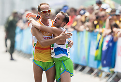 Blind Sandi Novak of Slovenia with guide Roman Kejzar celebrate at finish line of the Men's Marathon - T12 Final during Day 11 of the Rio 2016 Summer Paralympics Games on September 18, 2016 in Copacabana beach, Rio de Janeiro, Brazil. Photo by Vid Ponikvar / Sportida
