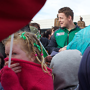 """School children brave the cold as Brian O""""Driscoll signs autographs as the Irish Rugby Team arrive at Queenstown airport for the IRB Rugby World Cup 2011, Queenstown, New Zealand, 1st September 2011. Photo Tim Clayton..."""