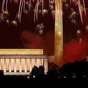 Fireworks rain down on the Lincoln Memorial and other Washington D.C. monuments on July 4th