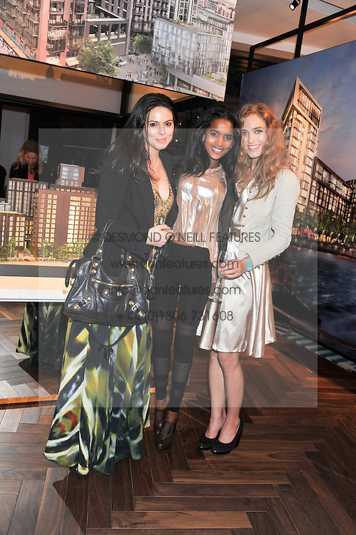 Left to right, ELENI RENTON, EDEN AMARE and INGRID WRISLEY at Inception Group's Hamptons Garden Party to celebrate their collaboration with Embassy Gardens 2016 held at the Ballymore Marketing Suite, Nine Elms Lane, London on 12th July 2012.