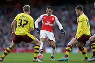 Alexis Sanchez of Arsenal is marked by Scott Arfield of Burnley and David Jones of Burnley. The Emirates FA cup, 4th round match, Arsenal v Burnley at the Emirates Stadium in London on Saturday 30th January 2016.<br /> pic by John Patrick Fletcher, Andrew Orchard sports photography.