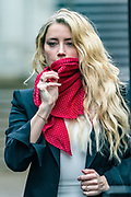 """US actress Amber Heard gestures and waves as she arrives at the High Court in London on Monday, July 27, 2020. <br /> She will attend a hearing in Johnny Depp's libel case against the publishers of The Sun and its executive editor, Dan Wootton when her defence is expected to wrap up their case. <br /> 57-year-old Depp is suing the tabloid's publisher News Group Newspapers (NGN) over an article which called him a """"wife-beater"""" and referred to """"overwhelming evidence"""" he attacked Ms Heard, 34, during their relationship, which he strenuously denies. (VXP Photo/ Vudi Xhymshiti)"""