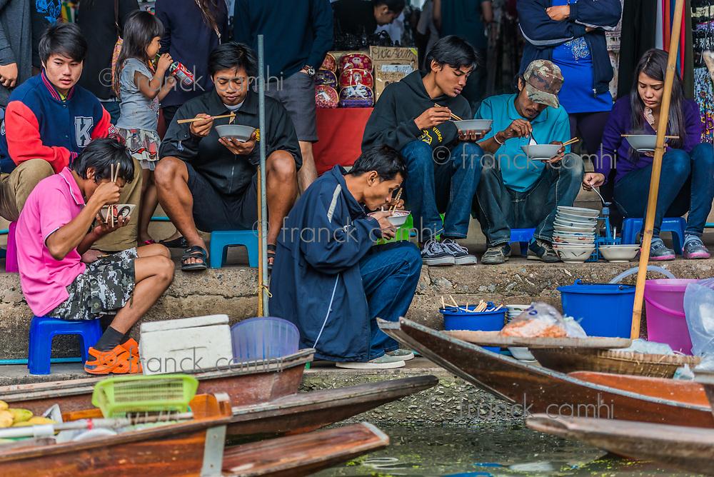 Bangkok, Thailand - December 30, 2013: people eating Amphawa Bangkok floating market at Bangkok, Thailand on december 30th, 2013