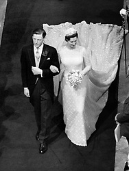 Princess Alexandra and her bridegroom Angus Ogilvy walking down the aisle leaving Westminster Abbey in London