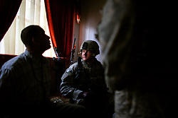 An engineer 1st Platoon Alpha Co. 3-25 BSTB 2BCT 82nd Airborne Division questions a suspected Shia militiamen before detaining him during a morning raid in the northern sector of the Baghdad Adhamiya district on Tuesday April 24, 2007.