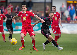 Brechin City's Scott Robertson and Arbroath's Gavin Swankie. Brechin City 1 v 1 Arbroath, Scottish Football League Division One played 13/4/2019 at Brechin City's home ground Glebe Park. Arbroath win promotion.