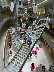 Interior of atrium of modern Stilwerk design shopping mall in Dusseldorf Germany