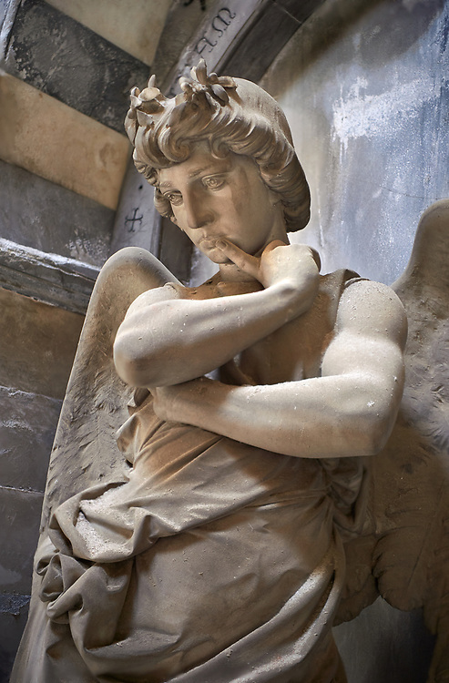 Picture and image of the stone sculpture of an agel in thought at the door of the tomb of the Mantero family. Art Nouveau style sculpted by L Orengo 1895. Section B, no 04, The monumental tombs of the Staglieno Monumental Cemetery, Genoa, Italy .<br /> <br /> Visit our ITALY PHOTO COLLECTION for more   photos of Italy to download or buy as prints https://funkystock.photoshelter.com/gallery-collection/2b-Pictures-Images-of-Italy-Photos-of-Italian-Historic-Landmark-Sites/C0000qxA2zGFjd_k<br /> If you prefer to buy from our ALAMY PHOTO LIBRARY  Collection visit : https://www.alamy.com/portfolio/paul-williams-funkystock/camposanto-di-staglieno-cemetery-genoa.html