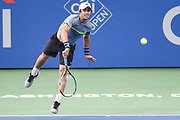 JORDAN THOMPSON hits a serve during his second round match at the Citi Open at the Rock Creek Park Tennis Center in Washington, D.C.