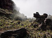 Bizarre rock formations in the clouds and mist on the top of Mount Roraima, a huge flat topped mountain in Venezuela