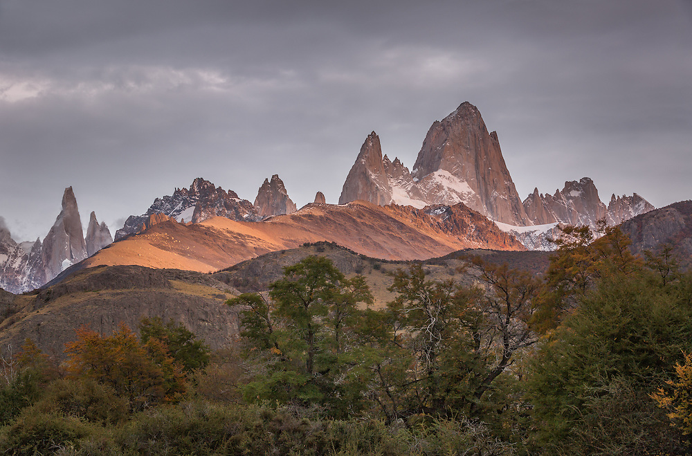 The first light of the sun fell on Cerro Chalten, also known as Monte Fitz Roy, and a darkening gray sky added some beautiful contrast.  Taken in Los Glaciares National Park, Argentinian Patagonia.