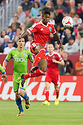 San Jose Earthquakes midfielder YANNICK DJALO (10)  leaps into catch a pass during a game again Seattle Sounders FC at Levi's Stadium in Santa Clara, California, on August 2, 2014.  The San Jose Earthquakes beat Seattle, 1-0.  (Stan Olszewski/SOSKIphoto)
