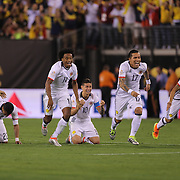 EAST RUTHERFORD, NEW JERSEY - JUNE 17: Colombia players react to Peru's final penalty miss to win the penalty shoot out, from left, Juan Cuadrado #11, James Rodriguez #10, Dayro Moreno #17 and Sebastian Perez #13 of Colombia during the Colombia Vs Peru Quarterfinal match of the Copa America Centenario USA 2016 Tournament at MetLife Stadium on June 17, 2016 in East Rutherford, New Jersey. (Photo by Tim Clayton/Corbis via Getty Images)