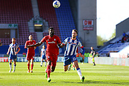 Bruno Ecuele Manga of Cardiff City (l) and Nick Powell of Wigan Athletic with their eyes on the ball. EFL Skybet Championship match , Wigan Athletic v Cardiff city at the DW Stadium in Wigan, Lancs on Saturday 22nd April 2017.<br /> pic by Chris Stading, Andrew Orchard sports photography.