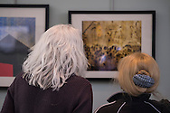 Manhasset, New York, U.S. February 15, 2015. L-R, GERALDINE HOFFMAN and AMY FINKSTON view photographs at the Artists Reception for 'A Personal Perspective' exhibit, by Long Island Center of Photography LICP photographers, at Shelter Rock Gallery at Unitarian Universalist Congregation.