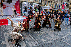 Edinburgh Scotland 7th August 2016 :: Performers from Fringe shows entertain in the High Street to promote their shows.<br /> <br /> Pictured:  Young Japanese dancers performs in the High Street.<br /> <br /> (c) Andrew Wilson   Edinburgh Elite media