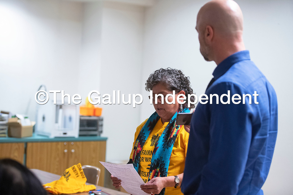 Janice Peterson, a member of Somos Gallup speaks to Bill McCamley, Cabinet Secretary for Department of Workforce Solutions at a Somos Gallup meeting Wednesday at the Octavia Fellin Public Library Children's Branch in Gallup. Peterson reads a statement about a compliant she filed in 2017 against her former employer Amazing Grace that has still not been resolved.