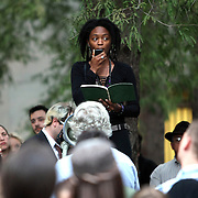 A supporter named Arianna speaks during an Occupy Orlando public demonstration in support of Occupy Wall Street gatherings across the country, at the Orange County History Center on Wednesday, October 5, 2011 in Orlando, Florida. (AP Photo/Alex Menendez)