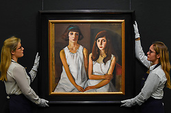 "© Licensed to London News Pictures. 22/11/2019. LONDON, UK. Technicians present ""Les Enfants"", 1923, by Boris Grigoriev (Est. GBP300-500k) at the preview for the upcoming sales of Russian artworks at Sotheby's New Bond Street.  The Russian Pictures and Works of Art, Fabergé and Icons sales take place on 26 November.  Photo credit: Stephen Chung/LNP"