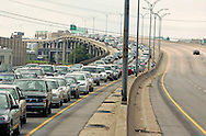 Cars carrying residents leave downtown New Orleans ahead of Hurricane Katrina August 28, 2005. Authorities in New Orleans ordered hundreds of thousands of residents to flee on Sunday as Hurricane Katrina strengthened into a rare top-ranked storm and barreled towards the vulnerable U.S. Gulf Coast city.  REUTERS/Rick Wilking