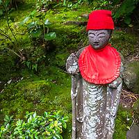 "Jizo at Hokoku-ji Bamboo Garden - Kamakura is world famous for its bamboo garden containing more than 2000 Moso bamboos trees. Its nickname is Take-dera ""Bamboo Temple"" for that reason.  The bamboo garden is punctuated with stone lanterns, jizo and moss covered stones.  Besides the popular bamboo garden, and teahouse, Hokokuji also has a often overlooked Zen garden   Ashikaga Ietoki, ordered Zen priest Tengan Eko to establish Hokoku-ji. This temple became the family temple of the Ashikaga clan. Tengan was a disciple of Mugaku Sogen a contemporary of famous garden designer Muso Kokushi."