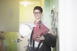 Mature woman open the door in the office and smiling, Freiburg im Breisgau, Baden-W¸rttemberg, Germany