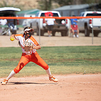 Gallup Bengals shortstop Savannah Watson (11) fields a grounder and prepares to throw to first base during their varsity softball game against the Bloomfield Bobcats Friday afternoon at Gallup High School in Gallup.