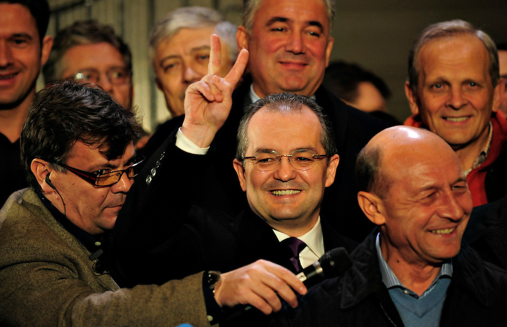 Emil Boc, the Romanian Prime Minister to be, smiles next to democrat Liberal party presidencial candidate Traian Basescu, after the exit-polls, regardless the fact they trailed Mircea Geoana by two procents. They ended up wining, and Emil Boc survived his andate, even if he was overrulled by the parliament.