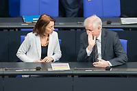 21 MAR 2019, BERLIN/GERMANY:<br /> Katharina Barley (L), SPD, Bundesjustizministerin, und Horst Seehofer (R), CSU, Bundesinnenminister, im Gespraech, vor Beginn der Bundestagsdebatte zur Regierungserklaerung der Bundeskanzlerin zum Europaeischen Rat, Plenum, Deutscher Bundestag<br /> IMAGE: 20190321-01-004<br /> KEYWORDS: Gespräch