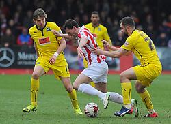Cheltenham Town's Matt Sparrow loses the ball to Plymouth Argyle's Peter Hartley - Photo mandatory by-line: Nizaam Jones - Mobile: 07966 386802 - 28/03/2015 - SPORT - Football - Cheltenham - Whaddon Road - Cheltenham Town v Plymouth Argyle - Sky Bet League Two