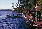 Canoes arriving at Voyageur Island, Nym Lake, Quetico Provincial Park, Ontario, Canada.