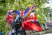 A protestor is seen waving a British bloodied flag during a protest organised by the Black Lives Matter movement in Parliament Square, Central London on Saturday, July 11, 2020. People are gathered to protest against systematic racial injustice in Britain. People most of them wearing protective face surgical masks in an effort to curb the spread of coronavirus pandemic outbreak, took part in the seventh weekend of anti-racism protests. <br /> Anger against systemic levels of institutional racism have raged through the city, and worldwide; sparked by the death of George Floyd who died on May 25 after he was restrained by Minneapolis police in the United States. (VXP Photo/ Vudi Xhymshiti)