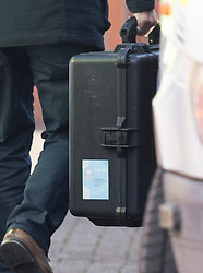 © Licensed to London News Pictures. 21/03/2018. Salisbury, UK. A man carries a case bearing a sticker of the Investigators from the Organisation for the Prohibition of Chemical Weapons (OPCW) as they arrive at The Mill pub in Salisbury aspolice continue their investigation after former Russian spy Sergei Skripal was taken after he and his daughter Yulia were poisoned with nerve agent. The couple where found unconscious on bench in Salisbury shopping centre. A policeman who went to their aid is currently recovering in hospital. Photo credit: Peter Macdiarmid/LNP