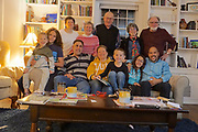 Family gathering at holiday includes grandmother and grandfather and two daughters' families as well as remarried grandparents spouses