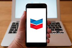 Using iPhone smartphone to display logo of Chevron oil and gas company