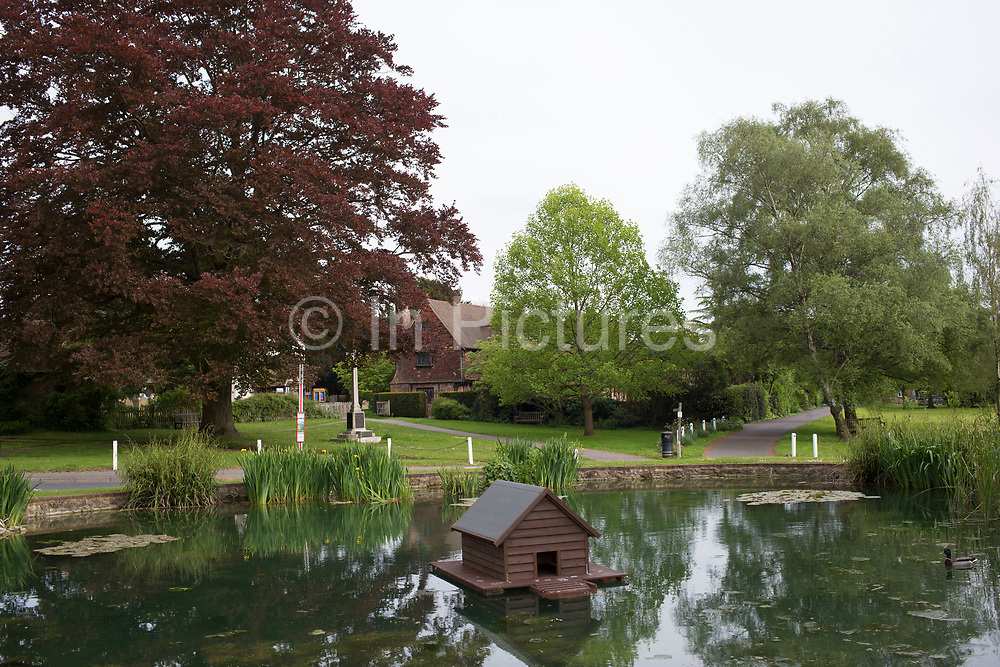 Roumer has it that this duck house is the smallest listed building in England. In fact the pond is the listed item and the duck house is new. Otford, Surrey, UK.