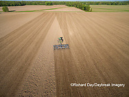 63801-10202 Farmer tilling field before planting corn-aerial Marion Co. IL
