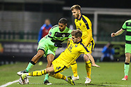 Forest Green Rovers Reuben Reid(26) is tackled by Oxford United's Luke Garbutt(3) during the The FA Cup 1st round replay match between Forest Green Rovers and Oxford United at the New Lawn, Forest Green, United Kingdom on 20 November 2018.