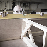 Craftsmen and carpenters constructing exhibition display stands