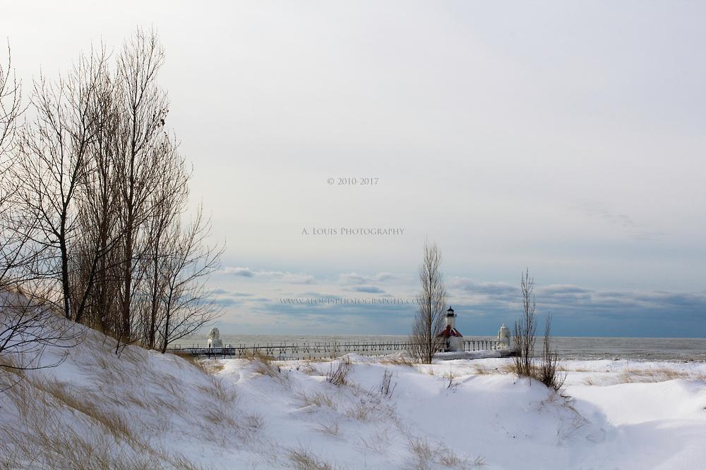 Winter scene of the St. Joe, Michigan piers.  Normal Edition.