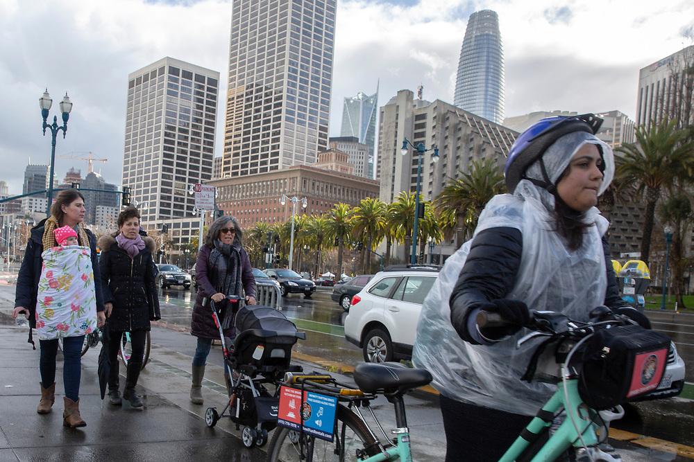 People make their way along the Embarcadero on Saturday, Feb. 9, 2019, in San Francisco, Calif.