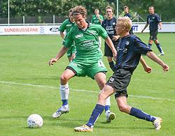 FODBOLD: Niels Peter Kjølbye (NKF) afleverer foran Dimitri de Martignac (Helsingør) under kampen i Kvalifikationsrækken, pulje 1, mellem Elite 3000 Helsingør og Nivå-Kokkedal FK den 6. august 2006 på Helsingør Stadion. Foto: Claus Birch