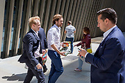 Beneath new architecture, City businessmen walk with their takeaway lunches along Bevis Marks in the City of London, the capitals financial district, on 17th June 2019, in London, England.